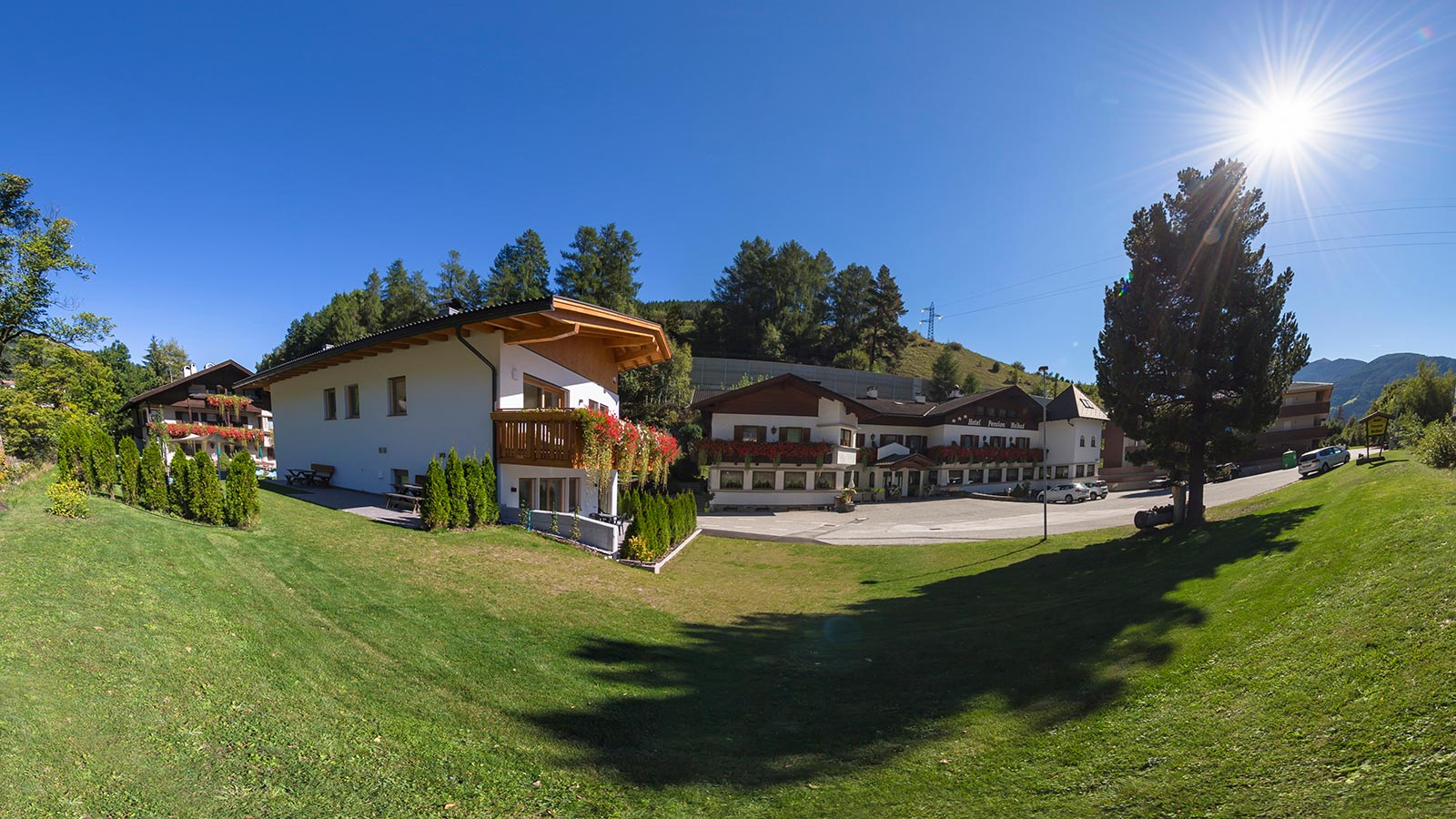 Hotel Maibad in Sterzing with its apartments on a warm sunny day